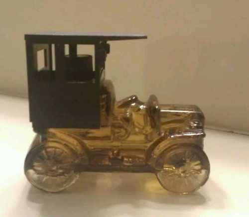 Avon gold car bottle